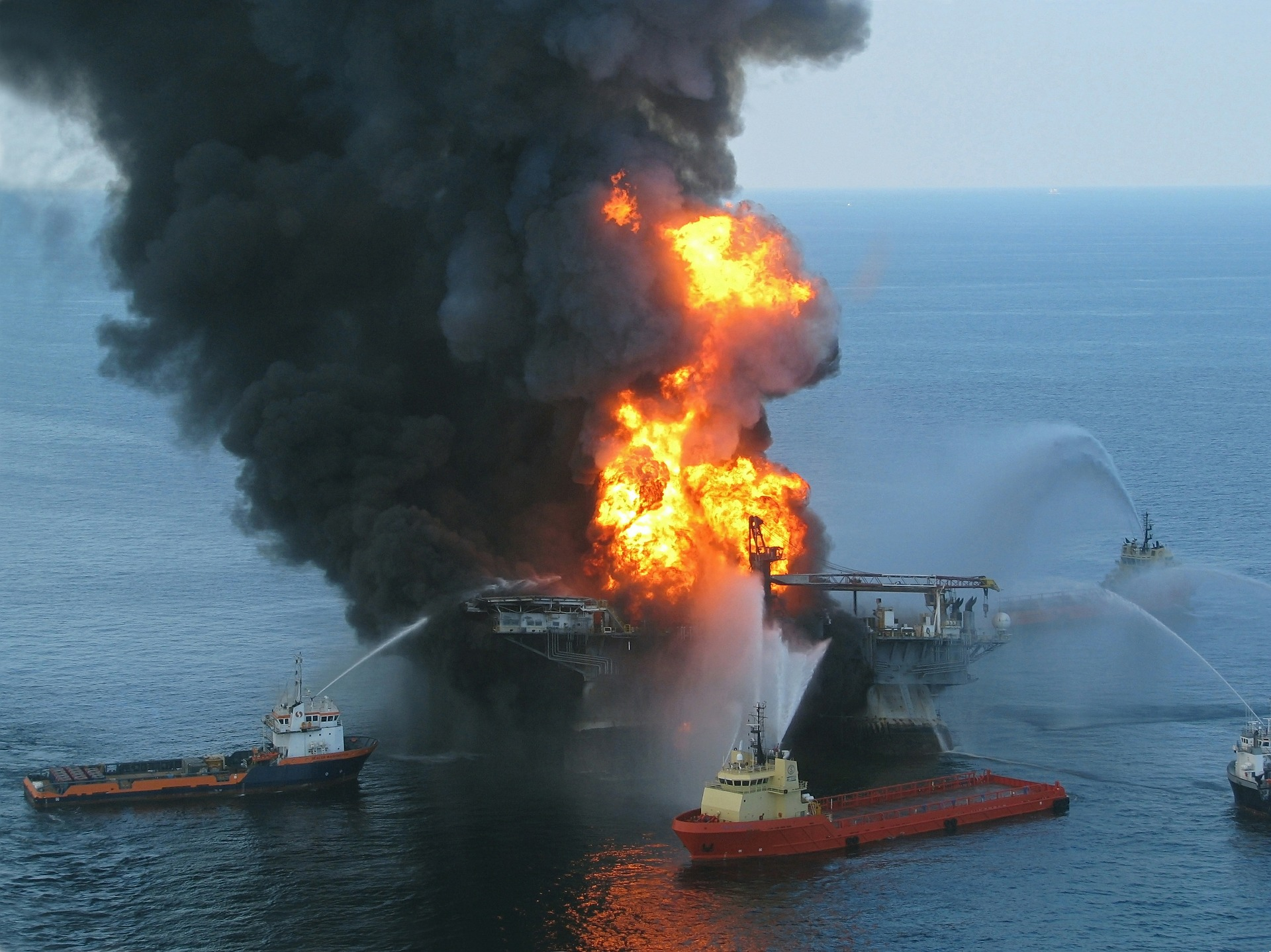An oil rig explodes in the Gulf of Mexico.
