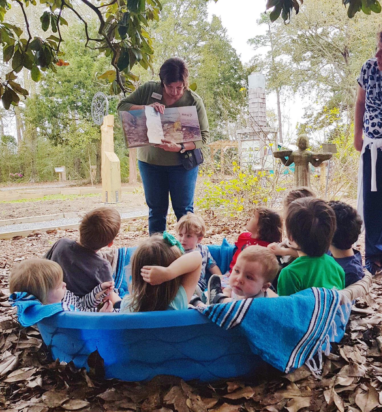 After learning about nests, these toddlers experienced the feeling of nesting together.