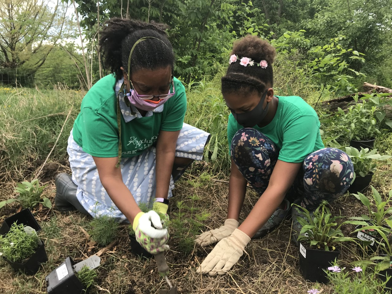 Delegate Robbyn Lewis, left, and Audubon Green Leader Olivia Wesby planting in the bird-friendly gardens of Patterson Park.