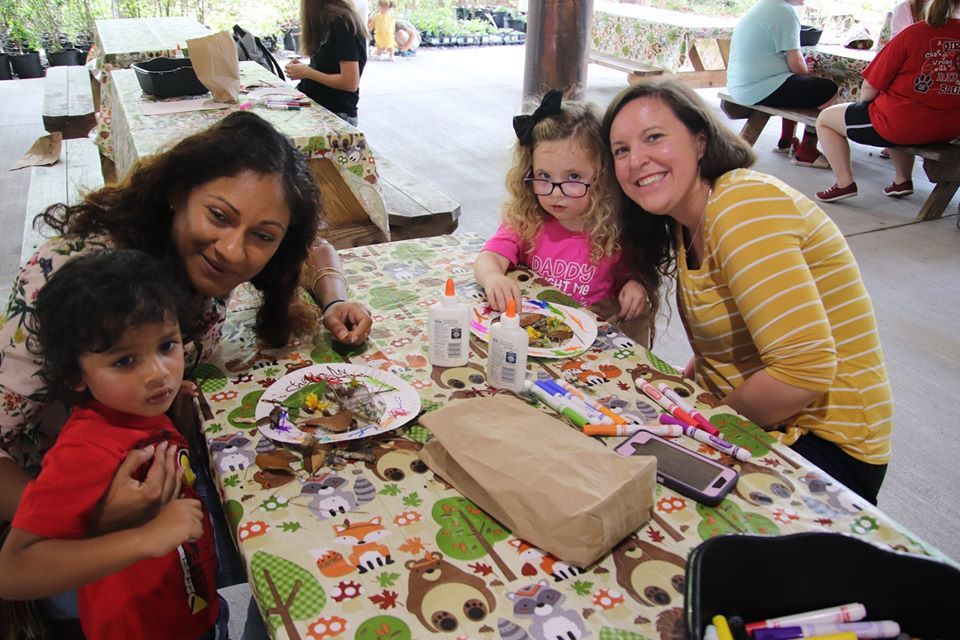Toddlers and their parents and grandparents enjoy a craft activity during our Toddler Tuesday Program.