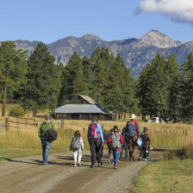Kids and adults walk at Four Mile Ranch.
